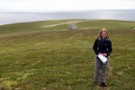 Debbie With Bonxie Stick, Foula, Airport In Background