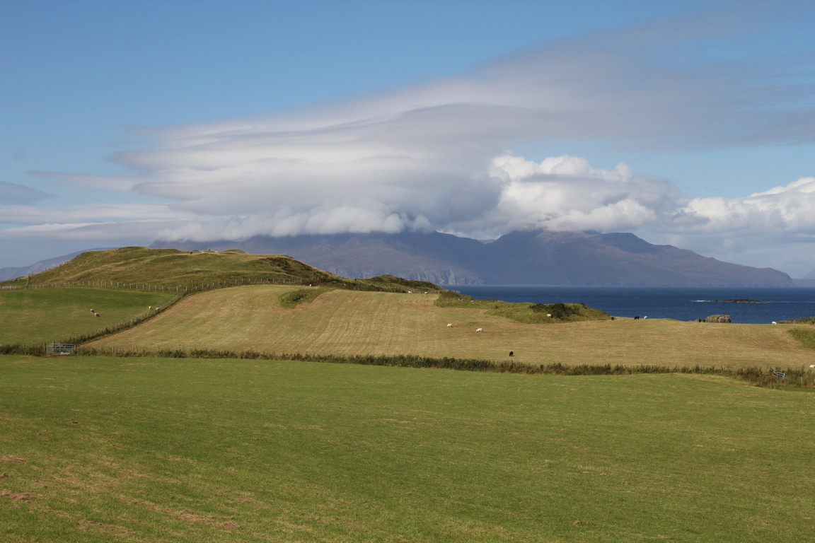 Muck, Spectacular Clouds over Rùm in Background