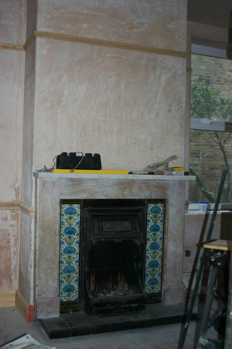 Living Room With Plaster And Fireplace