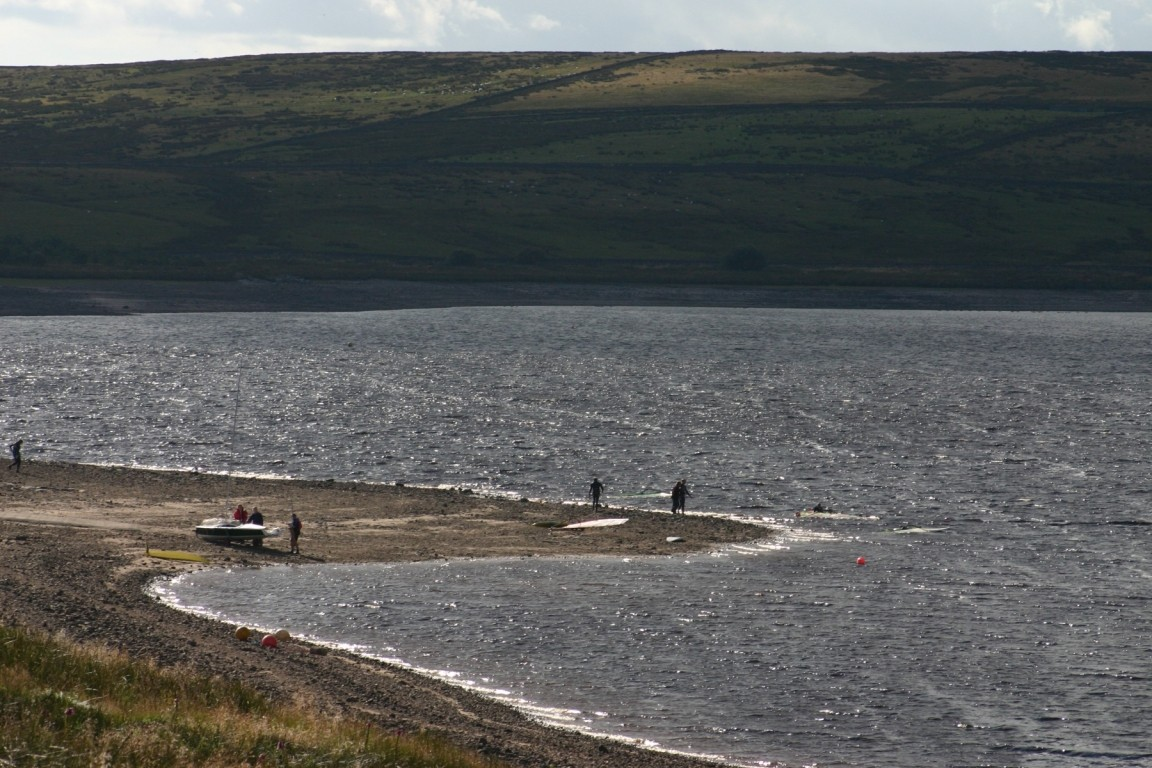 Windsurfers And Sailors On Shore Of Grimwith Reservoir