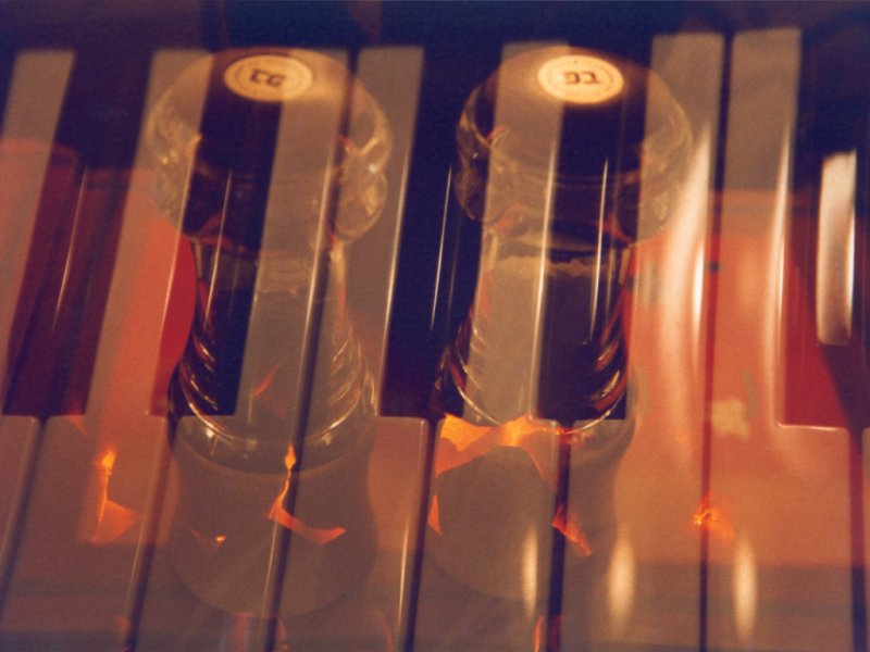 Multiple Exposure - Keyboard, Table Mats, Pepper Mill And The Fire